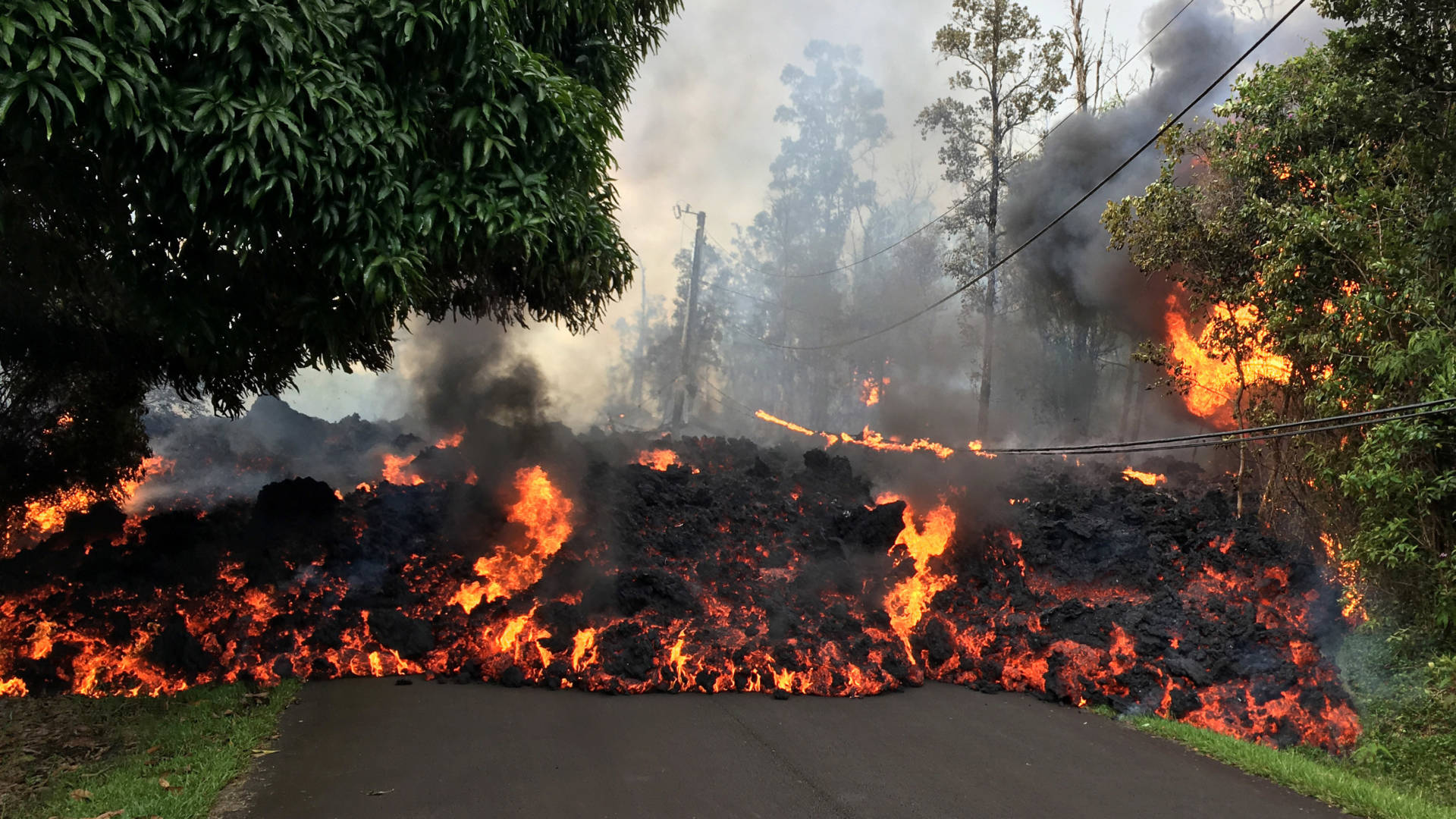 A lava flow moves on Makamae Street in the Leilani Estates subdivision on Sunday, following an eruption by Hawaii's Kilauea volcano. The governor of Hawaii has declared a local state of emergency and some 1,700 residents have been ordered to flee. U.S. Geological Survey/Getty Images