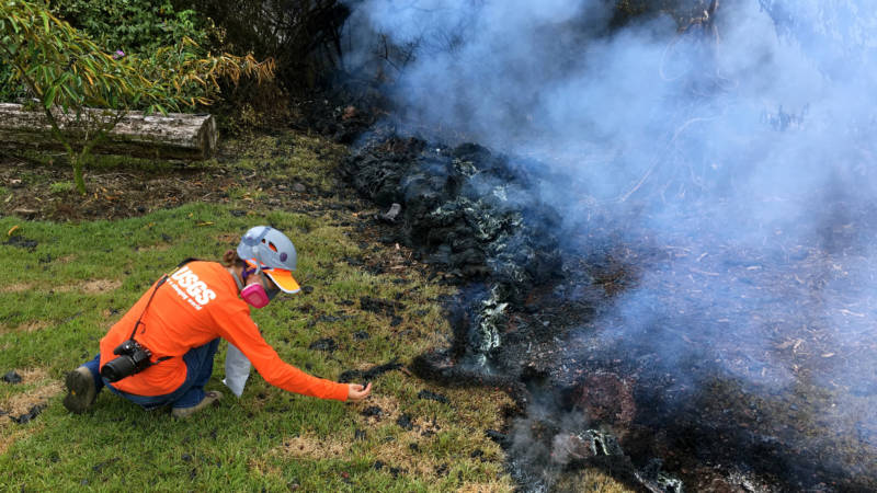 Hawaiian Volcano Observatory geologists collect samples of spatter for laboratory analysis on Sunday in the Leilani Estates subdivision near Pahoa, Hawaii.