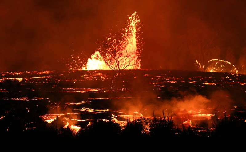 Lava erupts and flows from a Kilauea fissure on Friday in Kapoho, on Hawaii's Big Island.