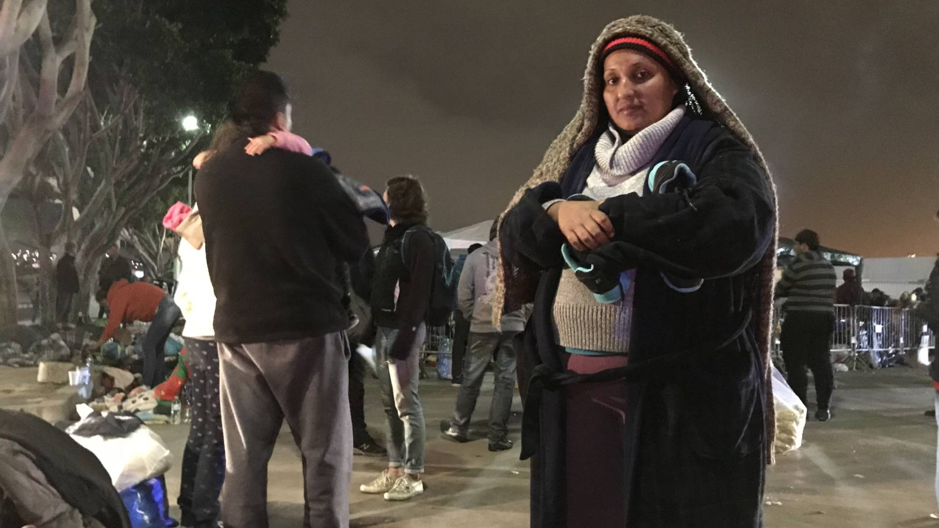 Deana Quczada of Honduras has been camping with her young children on the street in Tijuana for several days. Going back to the violence in her home country is not an option, she says. Kirk Siegler/NPR