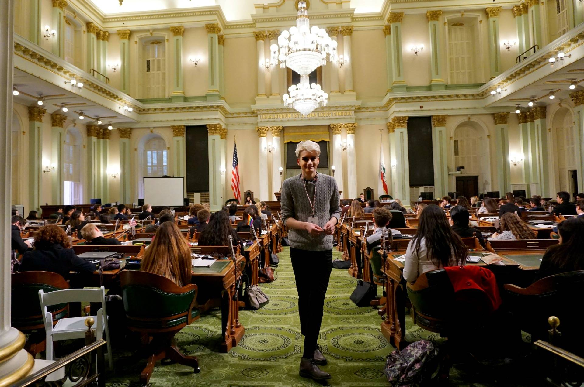 A page passes notes between members of the Assembly. Amanda Font/KQED