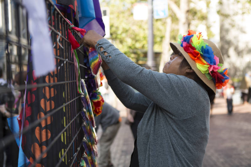 Mixima Lopez sets up her stall before the parade begins. Lopez traveled from Los Angeles for the event.