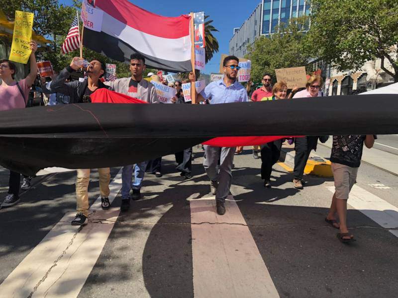 A contingent from the Yemeni Organization of Oakland marches in San Francisco's 'Families Belong Together' march. Spokesman Ameer Alkrizy says they're there to protest the Trump administration's travel ban, which targets five Muslim-majority countries, including Yemen. 'What's happening at the southern border basically is the same thing happening to Yemenis. Children are being taken from their parents when they try to come in,' he says.
