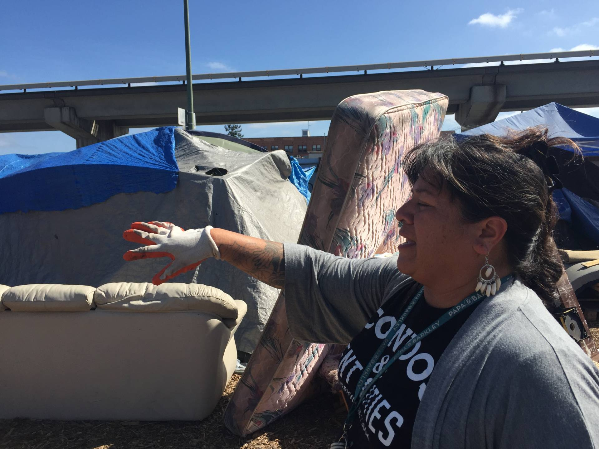 Needa Bee, lead organizer for The Village, at an East Oakland encampment this past summer.  Tara Siler/KQED