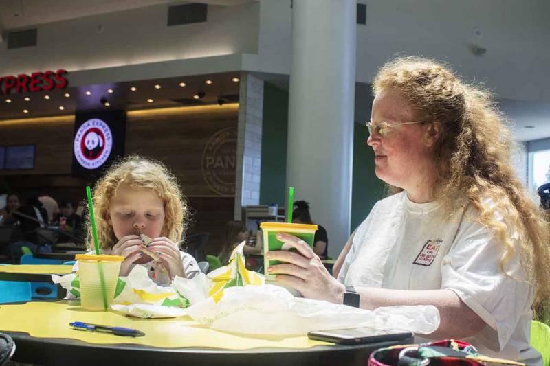 Thea Wickelgren, left eats lunch with her mom, Emily Wickelgren, at the Arden Fair Mall in Sacramento.