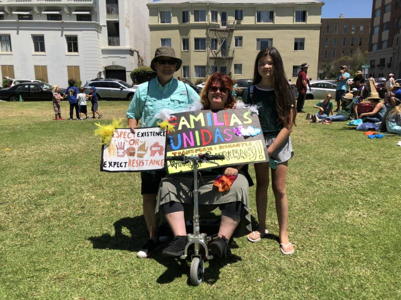 """I think it just sucks the way they're separating families, especially children. I can't even imagine if that happened to us and our daughter, it'd be the most devastating thing ever,' says Chino Scott-Chung (L) with his wife Maya Scott-Chung (C) and daughter Luna (R) at the rally in Oakland. 'My grandfather was Chinese and came to San Francisco and went to Mexico because of the Chinese Exclusion Act. My dad came to Angel Island in a boat as a young boy trying to escape war-torn China. His parents had to buy documents so he could come here, and our family lost our ancestral history. We lost that part of our names, our identity. And our Mexican part of the family can visit, but can never immigrate here.'"
