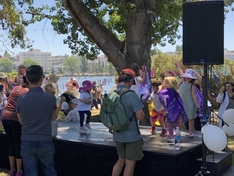 Kids have a dance party at the 'Families Belong Together' rally in Oakland near Lake Merritt.