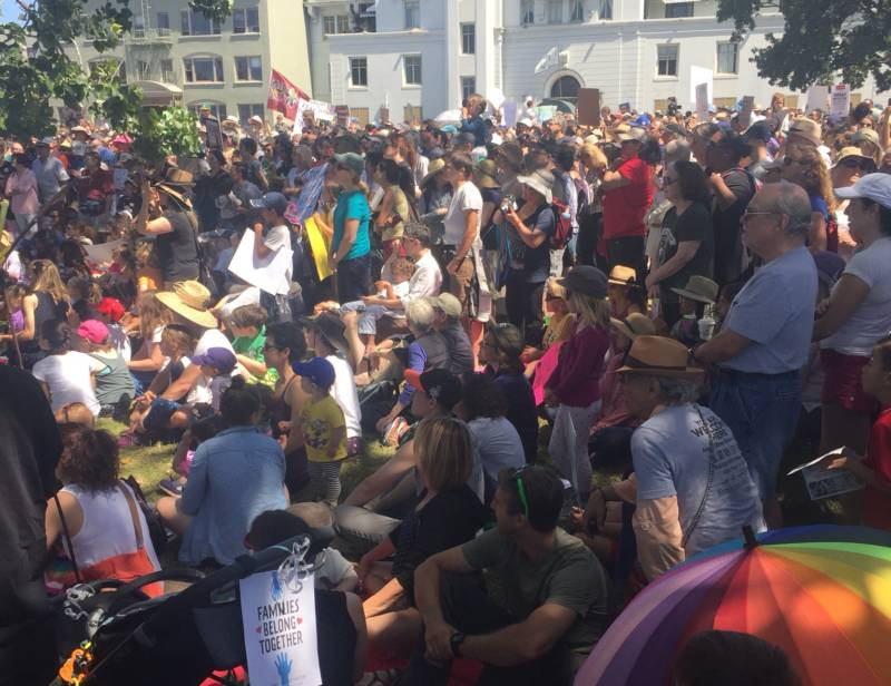A large crowd fills Lakeside Park in Oakland for a 'Families Belong Together' rally.