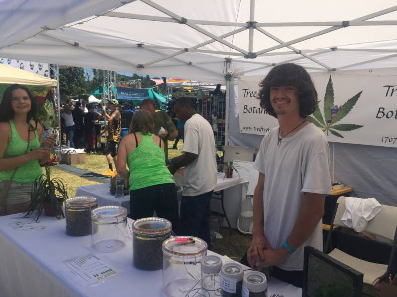 Jacob Richard works at the booth for his family's marijuana business that they run out of Humboldt County on June 2, 2018.