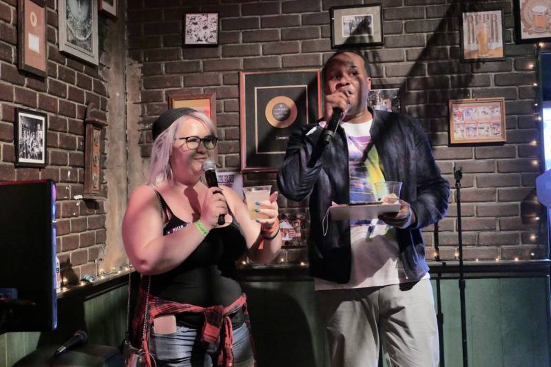 'The Daily Show' correspondent Roy Wood, Jr. emcees karaoke at Clusterfest as the first singer, Em Rodenski of Concord gets ready to perform 'Semi-Charmed Life' by Third Eye Blind.