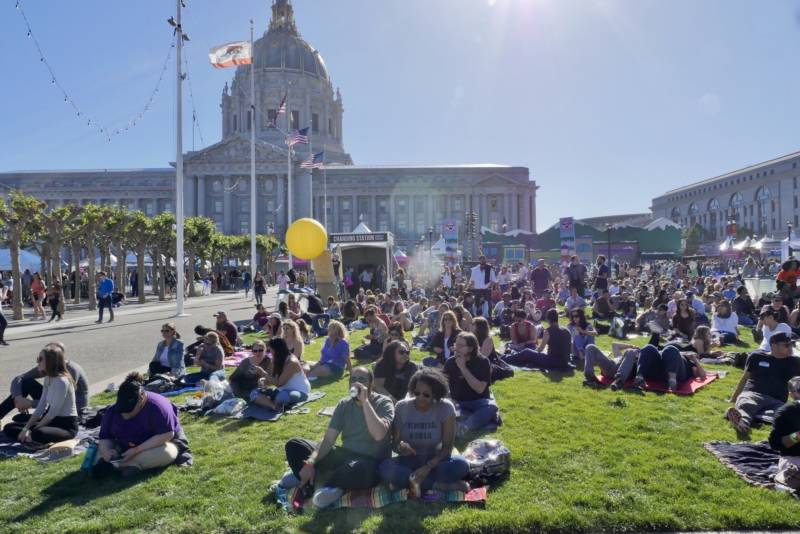 Festivalgoers relax at Civic Center Plaza in San Francisco during Clusterfest. The festival premiered in June 2017, and organizers said more than 45,000 people attended over its initial three-day run.