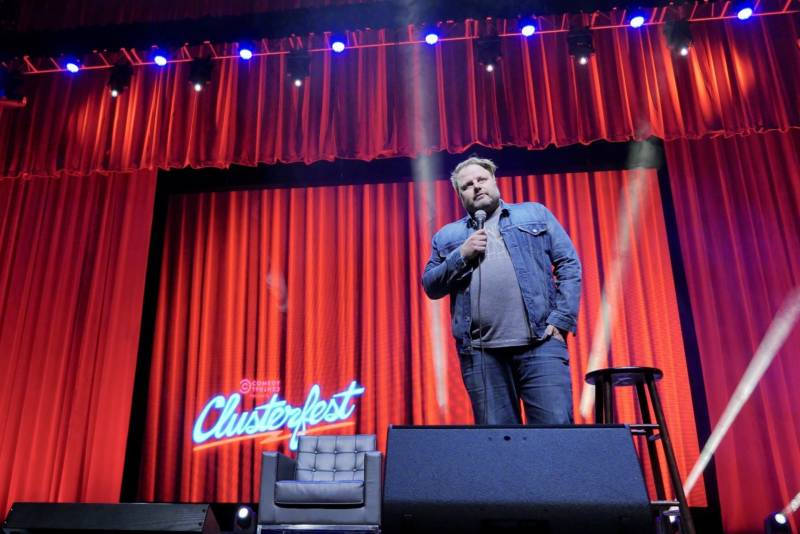 Marine biologist turned stand-up comedian Forrest Shaw performs onstage inside Bill Graham Civic Auditorium at Clusterfest.
