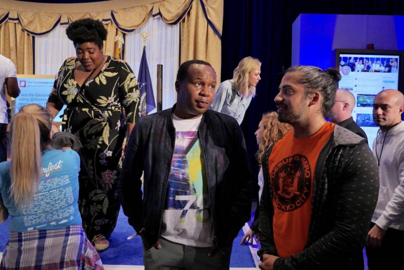The Daily Show correspondent Roy Wood, Jr. talks to a festival goer inside the Donald J. Trump Presidential Twitter Library at Clusterfest. Wood Jr. performed three times during the weekend.