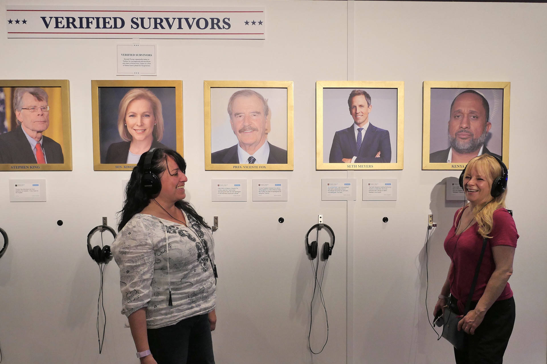 Diana Gaffney, L, and Tina Suca, R, listen to recordings of celebrities and politicians who have battled with President Trump on Twitter and survived at the Donald J. Trump Presidential Twitter Library at Clusterfest in San Francisco. Sheraz Sadiq/KQED