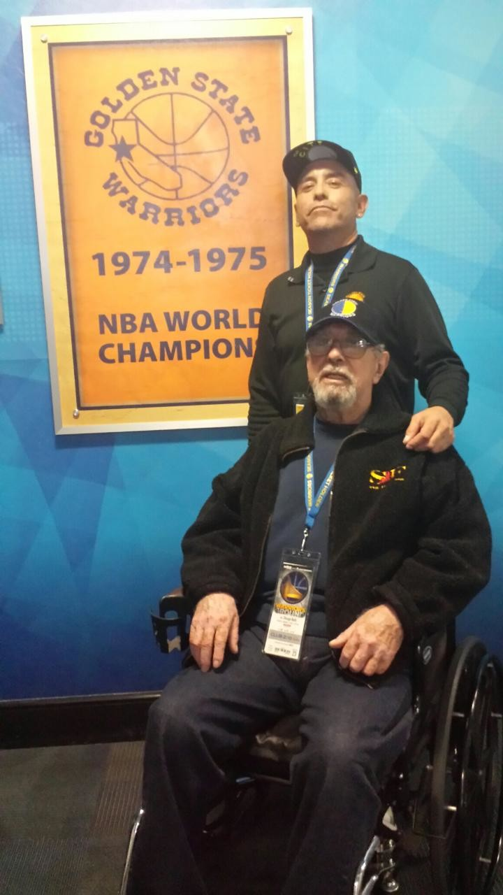 Mo Sanchez (standing) and his father Alfredo Sanchez Sr. at a Golden State Warriors game at Oracle Arena. Sanchez's father passed away two years ago from cancer. 'He'd be ecstatic,' Sanchez said if his father were still alive today. 'He'd be the most happiest man in the Bay Area.'