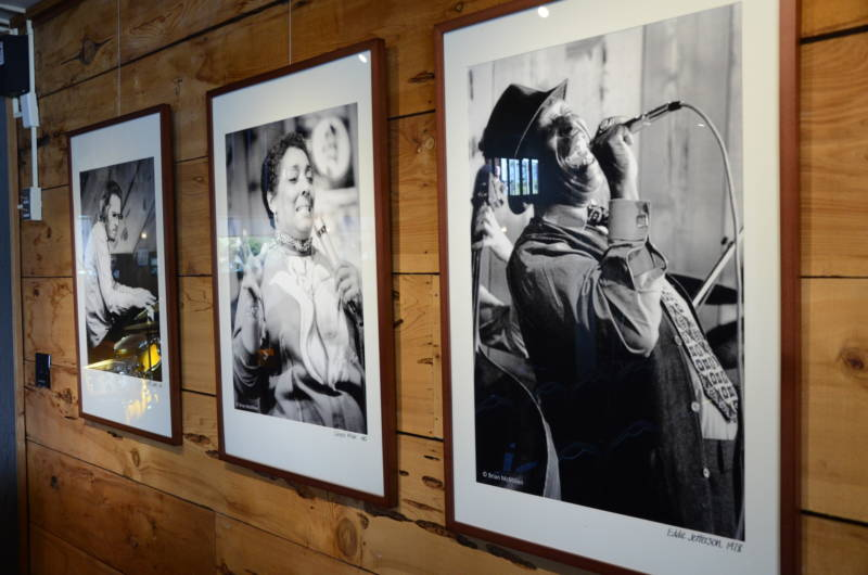 Photos of jazz greats including Carmen McRae, Bill Evans and Eddie Jackson line the wood-paneled walls of the present-day Bach concert room.