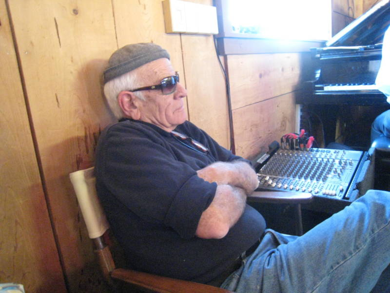 Pete Douglas running the sound system just off of stage right in the performance room at the Bach Dancing and Dynamite Society. Douglas died in 2014.