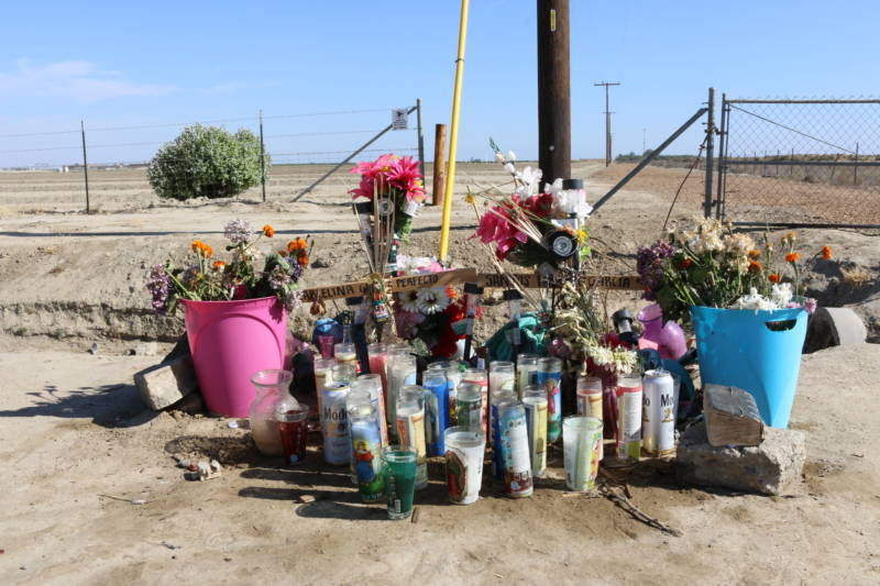 A roadside memorial to Santos Hilario Garcia and Marcelina Garcia Perfecto, who died while fleeing ICE agents on March 13, still stood at the site of the accident on a rural road in Delano over two months later.