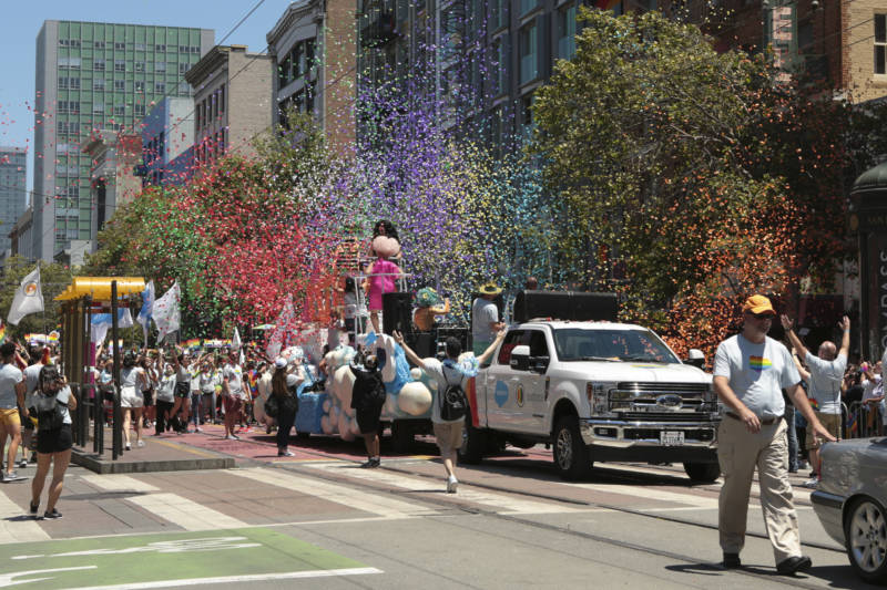 Bits of rainbow-colored paper spray into the air as the Salesforce float passes along Market Street. There were more than 280 contingents in the parade, according to organizers.