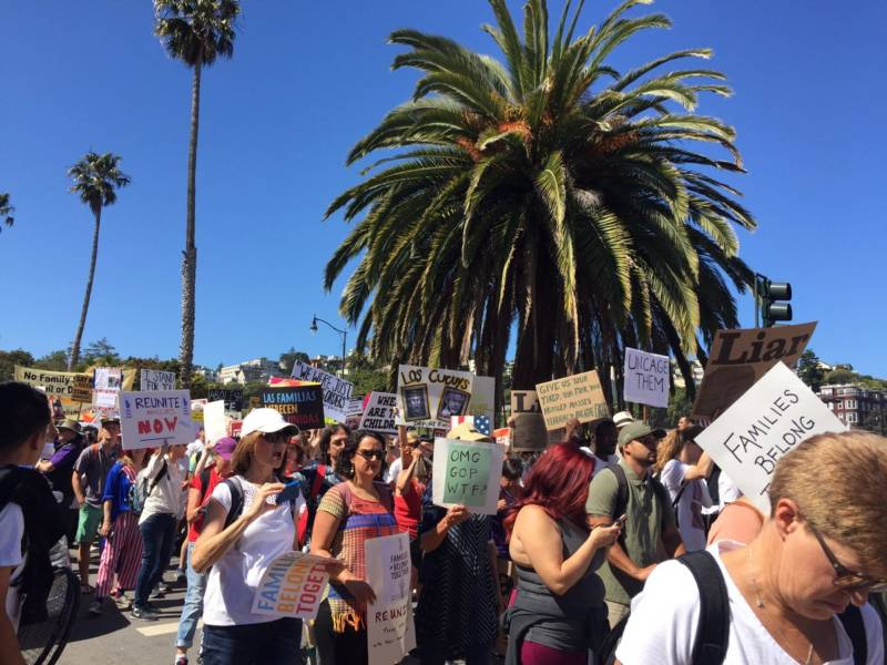 Demonstrators prepare to march from Dolores Park to San Francisco's Civic Center Plaza for the city's 'Families Belong Together' march.