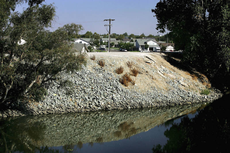 A levee holding back the waters of the Sacramento-San Joaquin River Delta in Stockton, pictured in 2005.