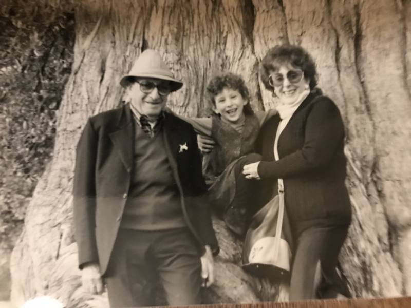 Sarah Stroe with her paternal grandparents, Mara and Angelo Stroe, in San Francisco's Golden Gate Park in the early 1990s.