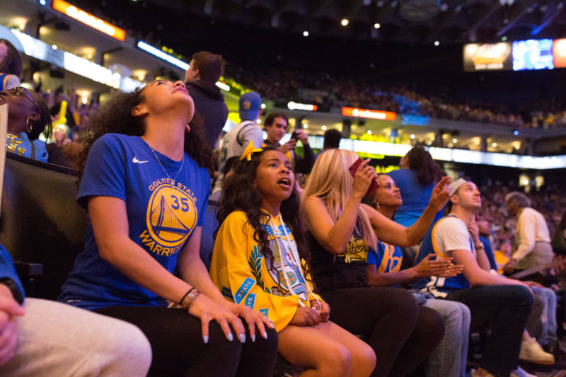 Fans react to the last minutes of the 4th quarter as the Warriors secure their win over the Cleveland Cavaliers on June 8, 2018.
