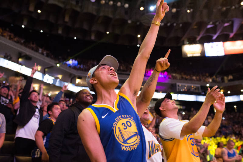Urias Escudero of San Jose cheers as the Warriors secure their win over the Cleveland Cavaliers on June 8, 2018 at the Warrior Watch Party at Oracle Arena in Oakland.