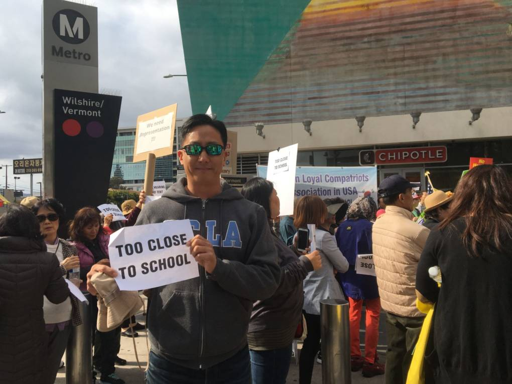 """After 1992 when this community was burned to the ground, it was built up by the blood, sweat and tears of Korean Americans. And it's just finally been revitalized and has actually been improving for the past couple of decades,"" said protester Emmanuel Han."