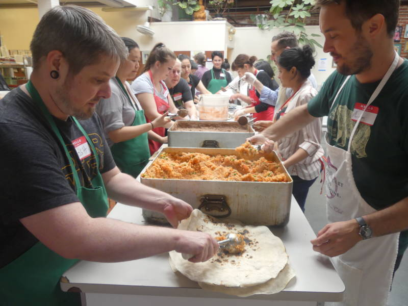 Once the assembly line got going, a mix of regular and newbie volunteers were able to put together hundreds of burritos in an hour.