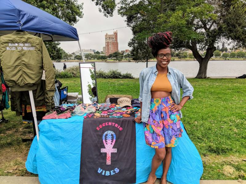 """Imani Baylor runs a vintage clothing business called Eccentric Vibes. She says the event feels like a family reunion. 'It's magnetic. People are walking down the street and you hear, """"Hey queen! What up, cousin! Hey, nephew!"""" It's like we are all family here.'"""