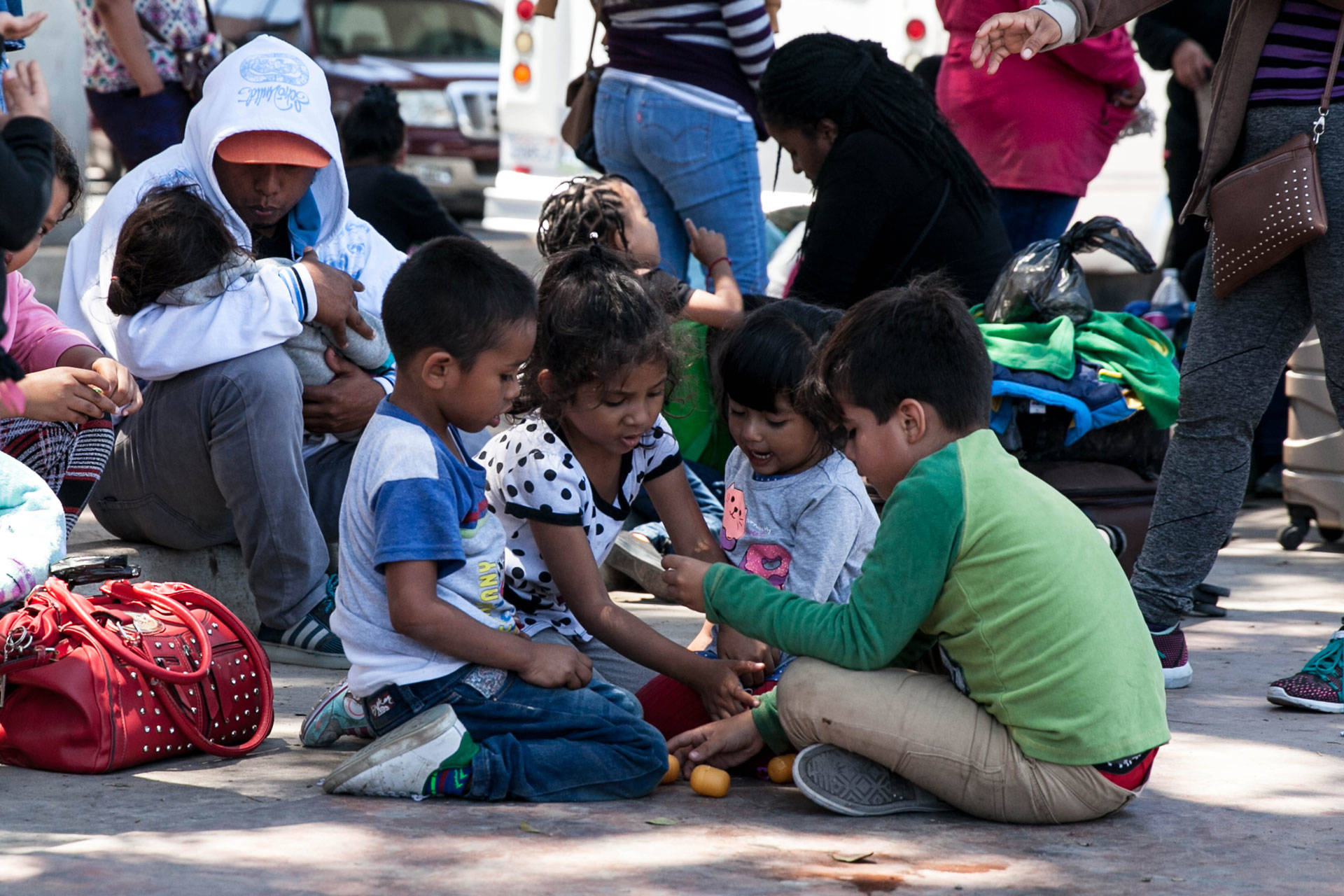 Children play as their parents wait on the Mexican side of the border, in the hopes of entering the U.S. legally by applying for asylum. The families waiting underwent arduous journeys from multiple continents, many spending their life savings to get here. Ariana Dreshler/KQED