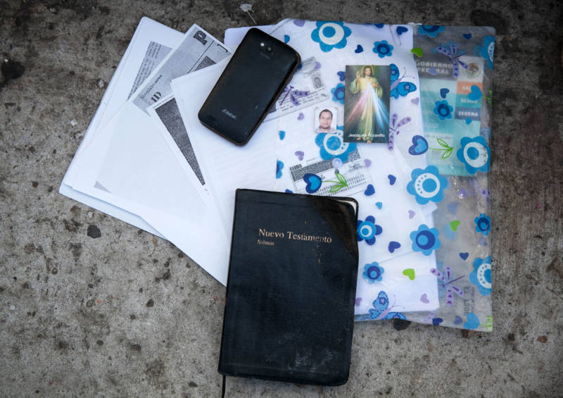 Birth certificates, IDs, prayer cards and a bible are among the items carried by those waiting to apply for asylum.