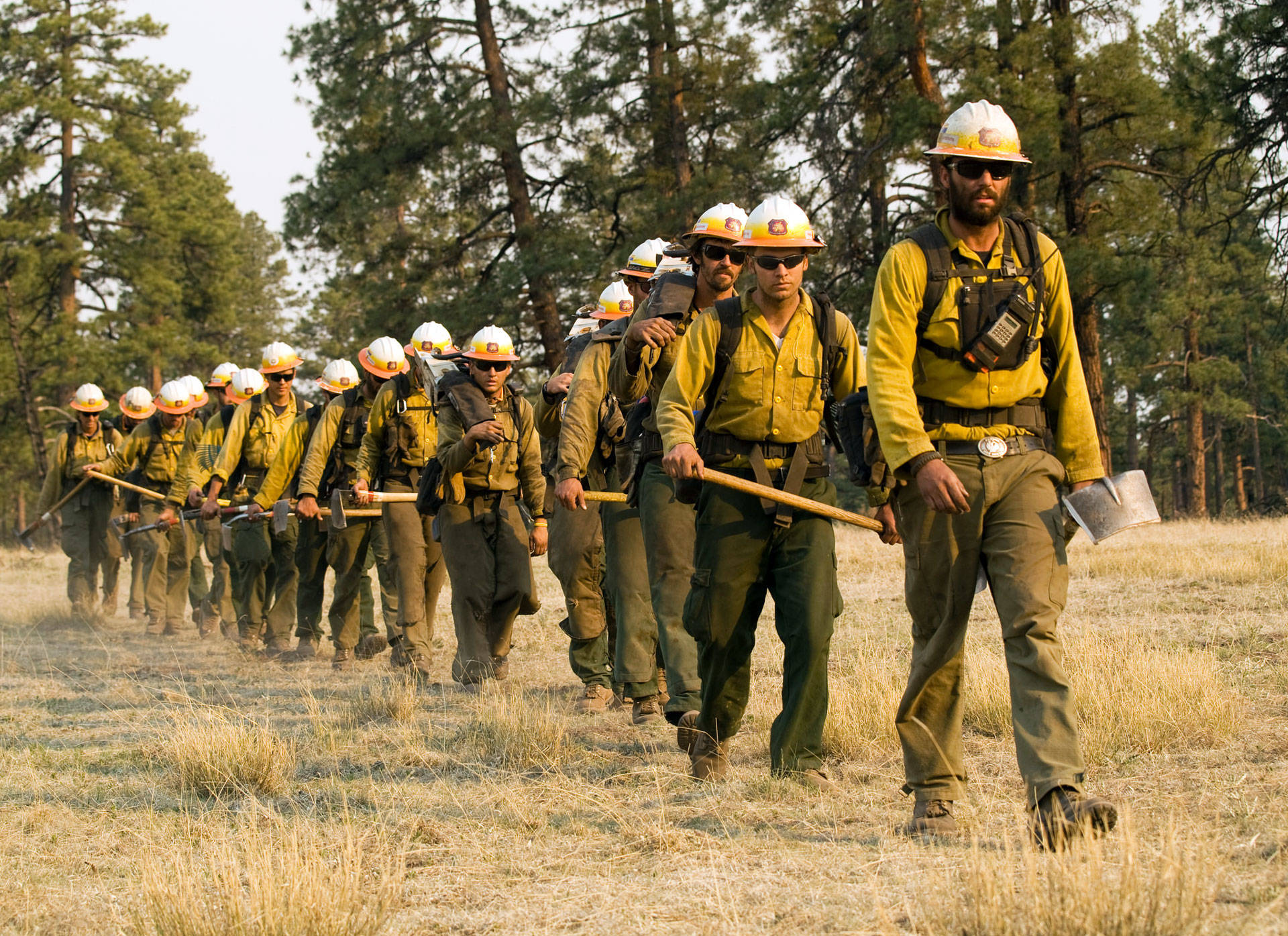 Wildland firefighters, like this crew heading into New Mexico's Gila National Forest, in 2012, are equipped and operate differently from urban firefighters. USFS Gila National Forest, CC BY-SA