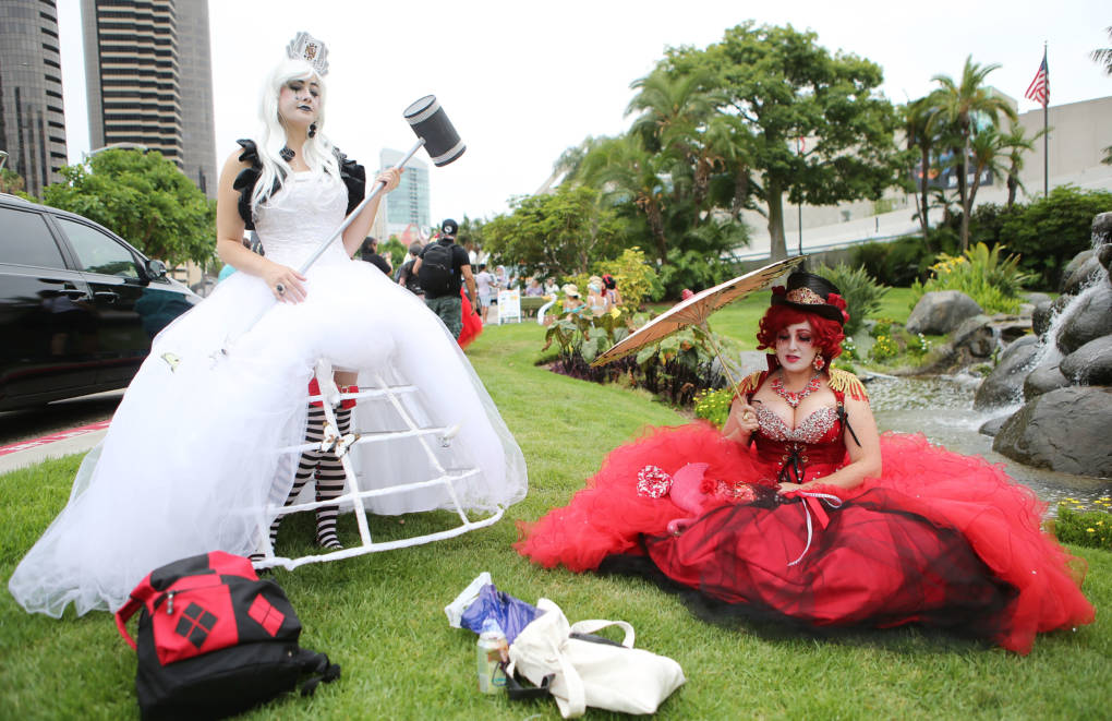 Cosplayers pose while dressed as the White Queen and Queen of Hearts outside Comic-Con on July 20, 2018 at the San Diego Convention Center.