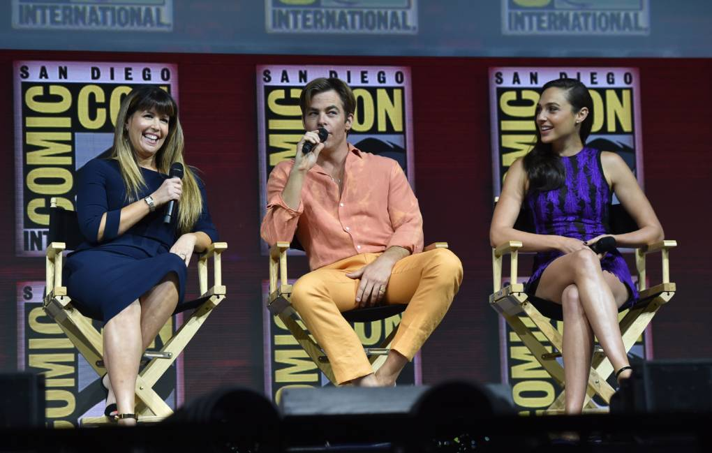 (L-R) Director Patty Jenkins, and actors Chris Pine and Gal Gadot participate in the Warner Bros. Theatrical Panel for 'Wonder 1984' during Comic Con in San Diego.