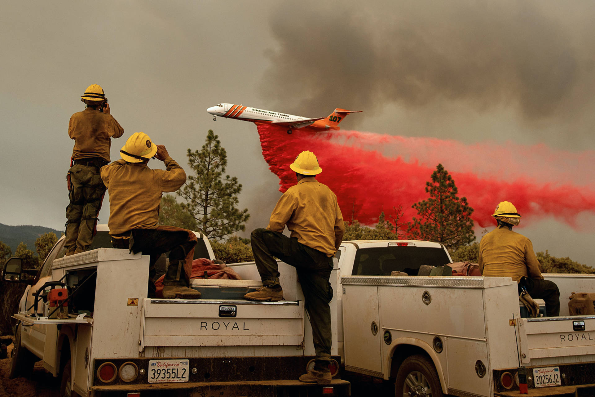 Firefighters watched Saturday (July 21) as an air tanker dropped retardant while battling the Ferguson Fire in the Stanislaus National Forest, near Yosemite National Park. Noah Berger/AFP-Getty Images