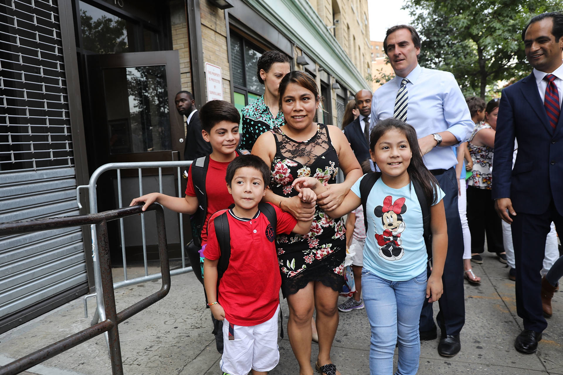 Yeni Maricela Gonzalez Garcia (center) stands with her children 6 year-old Deyuin (left), 9 year-old Jamelin (right) and 11 year-old Lester (back) as she and her lawyer speak with the news media after she was reunited with her children at the East Harlem Cayuga Centers on July 13, 2018 in New York City. Gonzalez Garcia, from Guatemala, drove cross-country to be reunited with her three children after they were taken from an Arizona immigration facility over eight weeks ago. Gonzalez Garcia crossed over the U.S. border with her three children on May 19, only two days before they were taken from her as part of President Donald Trump's controversial zero-tolerance policy of removing immigrant children from their parents after they are detained. Spencer Platt/Getty Images