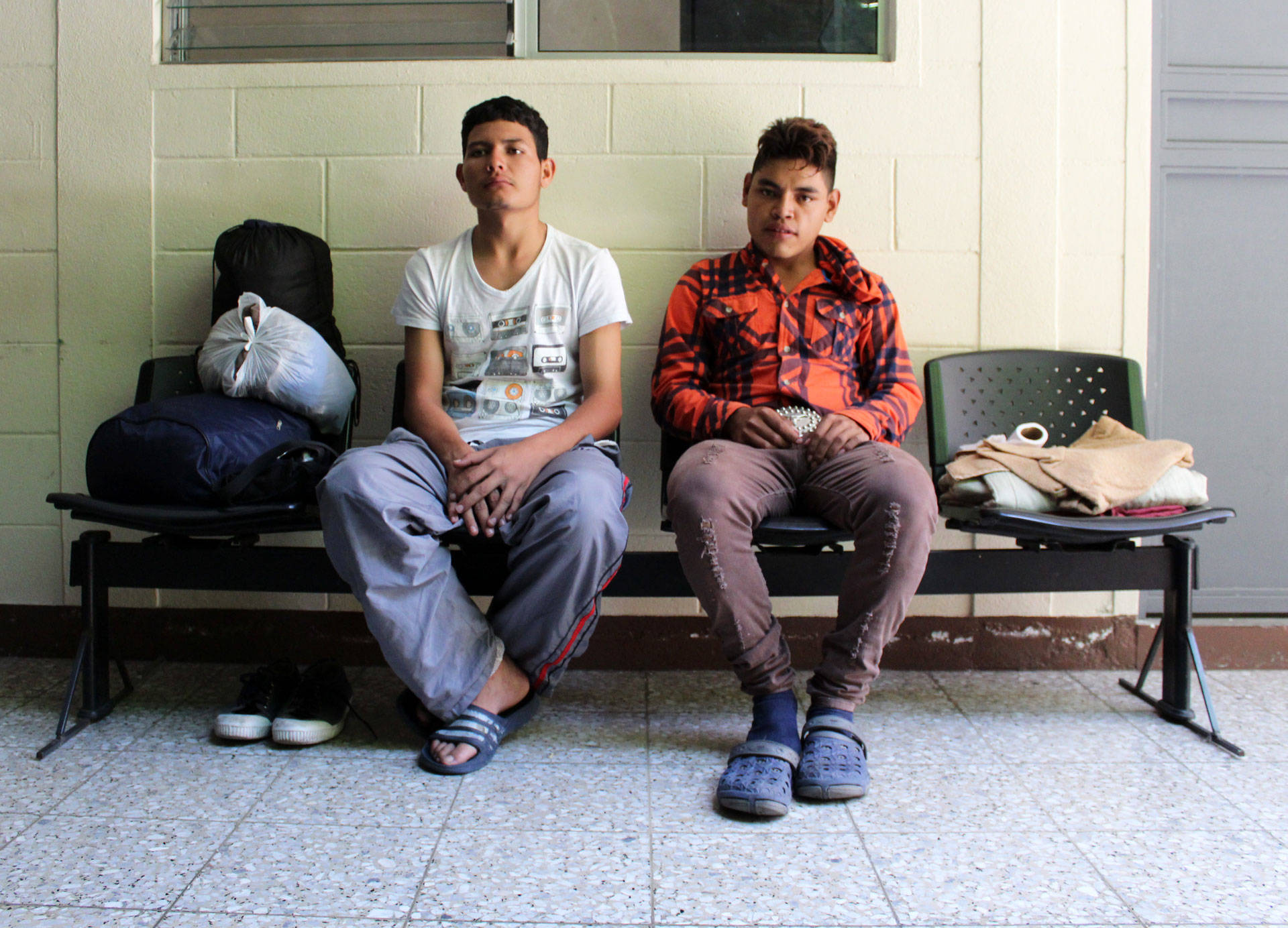 Two men wait for social services in Zona 1, Guatemala City. John Sepulvado/KQED