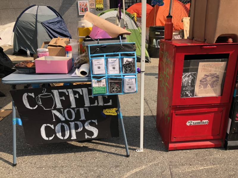 Supporters provided coffee and donuts to those protesting outside the ICE building in San Francisco on Tuesday morning.