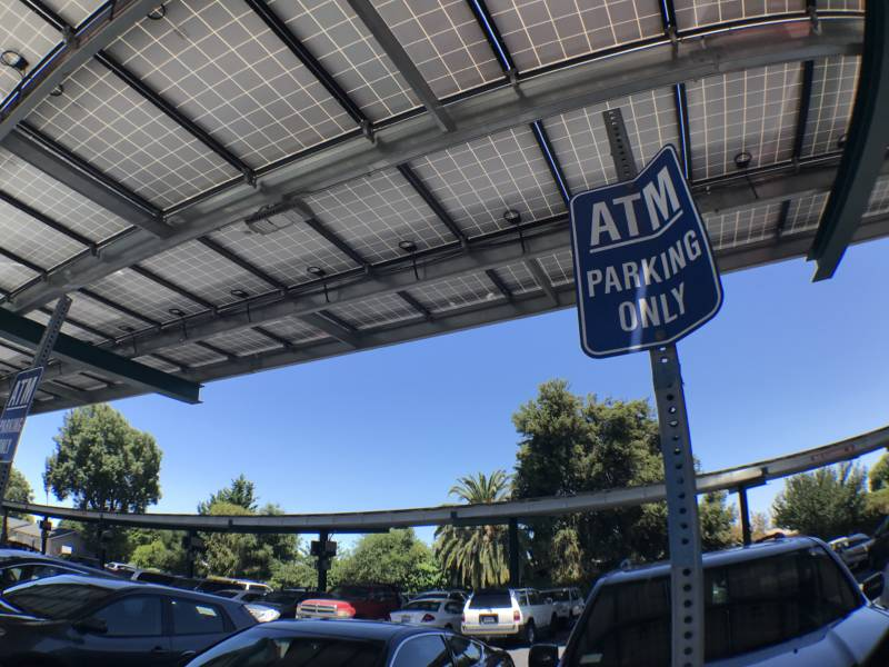 Parking sign for an ATM near East Palo Alto Government Center.