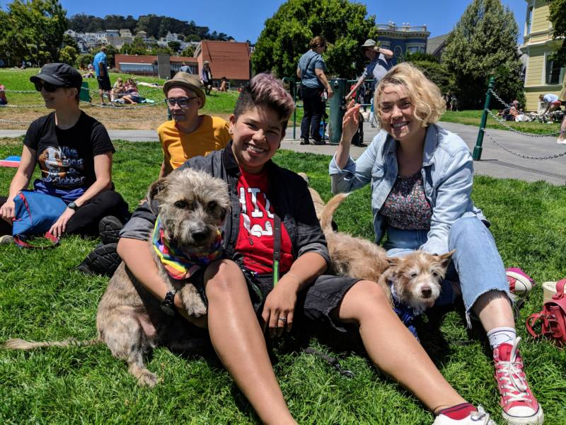Sarah Buyco (left) and Tyler Weber (right) with their dog Penny, a pit bull / terrier mix who was born without a fourth leg. 'She's forever a puppy, super happy and friendly,' says Weber. They both fostered other dogs with Wonder Dog Rescue in San Francisco.