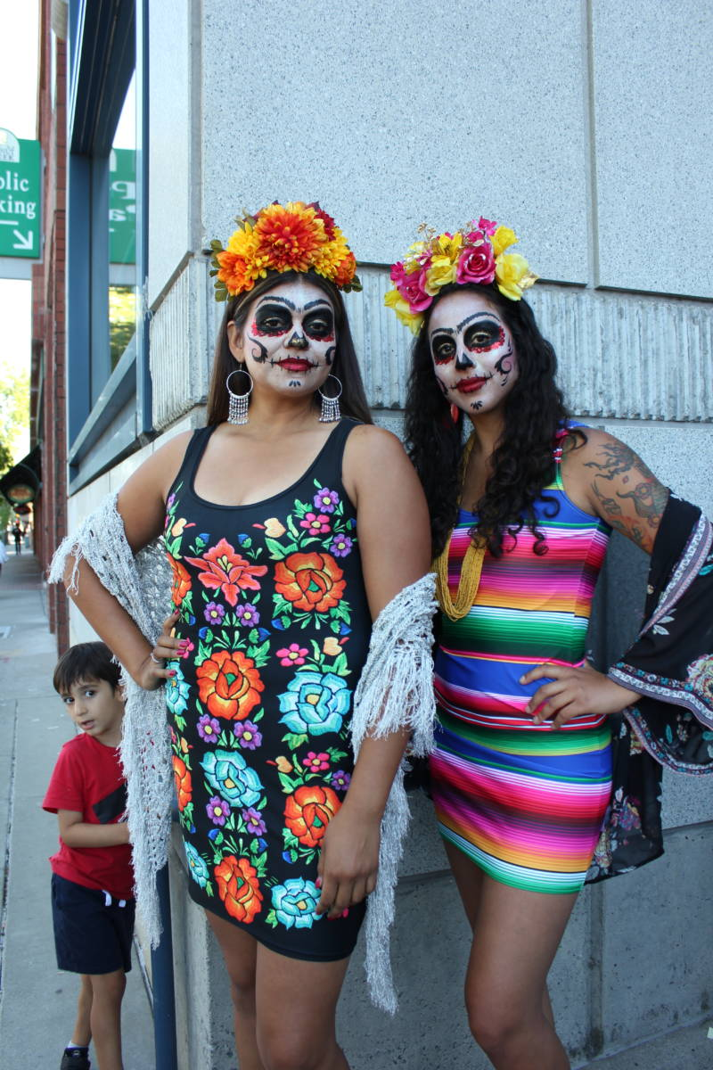 "Vanessa Hernandez of Oakland and Gloria Magaña of Modesto prepare to walk in the Frida-inspired fashion show. Hernandez says Kahlo, to her, is ""power."""