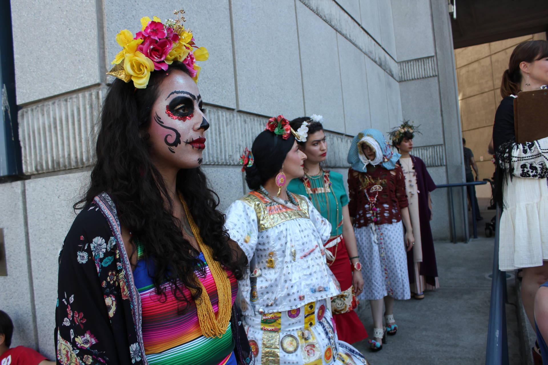 "Gloria Magaña of Modesto waits to walk the Frida Kahlo fashion show runway outside the Bedford Gallery in Walnut Creek. Of Kahlo, she said, ""She's weird, and I like it."" Sara Hossaini/KQED"