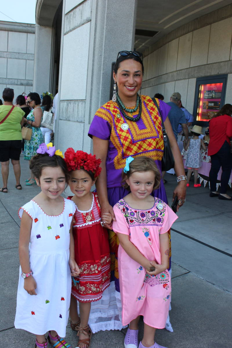 Rachel-Anne Palacios and from L to R: Azalia Cabrera (5), daughter Mayahuel Palacios (5) and Lucia Soriano (4) hang out at the Frida Kahlo celebration. The girls participated in an earlier Kahlo look-alike contest.