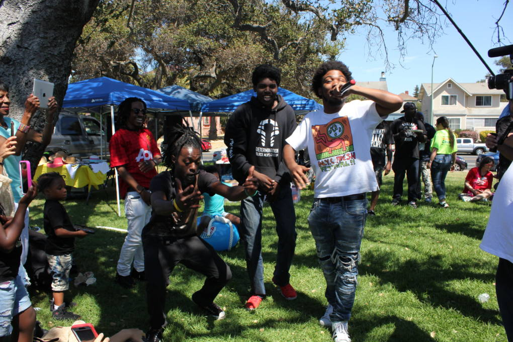 "Members of Urban Peace Movement, L-R Erik Wright, Roy Terry, Ronnie Coleman and Jamel Patterson rap ""3am in Oakland"" at the March for Our Lives barbecue. Wright says, ""I hope we do all the things we're talking about at the barbecue, vote, and positivity."""