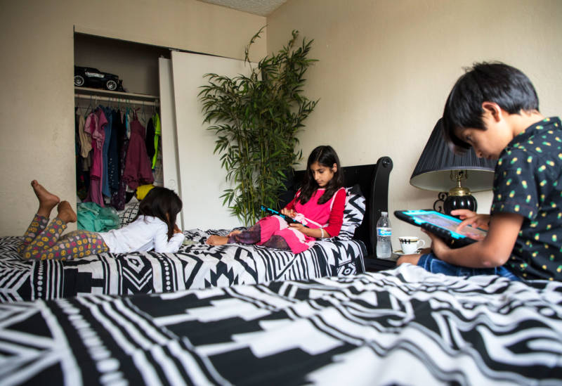 Shukula, Sameera and Mirwais Jan (left to right) in the bedroom they share.