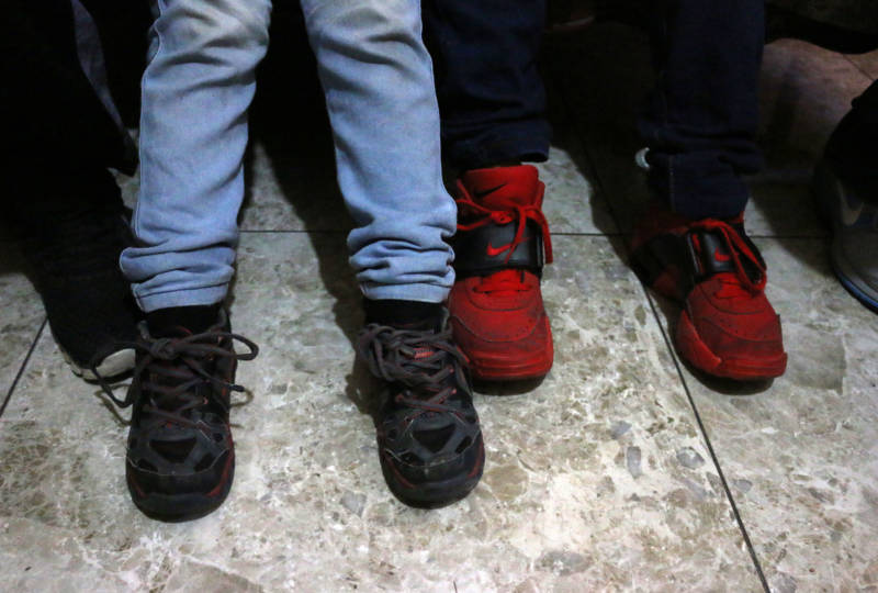 Elizabet's five and nine-year-old sons' shoes. The boys repeatedly told their mother they were hungry while in Customs and Border Protection custody at the Calexico West border facility.