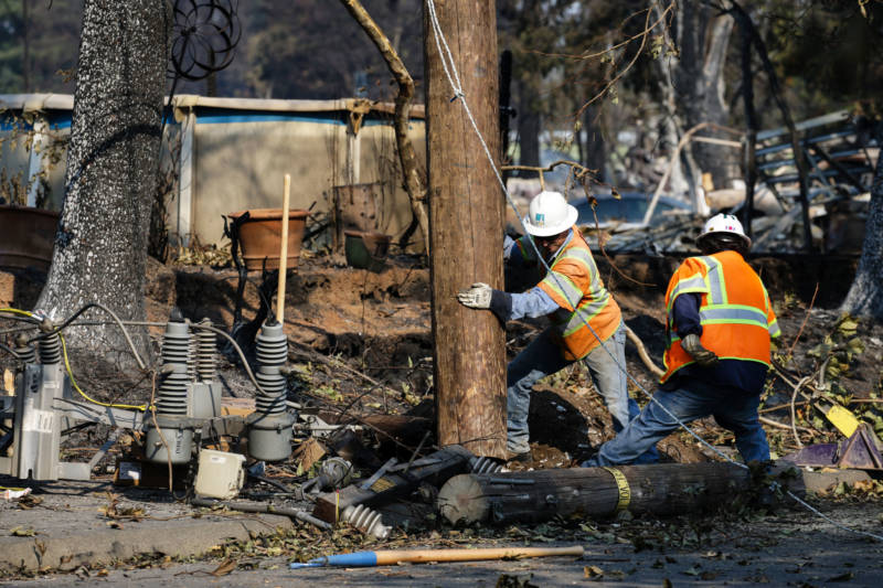 PG&E workers work to repair power lines in the Coffey Park neighborhood following the devastation caused by the Tubbs Fire on October 13, 2017 in Santa Rosa.