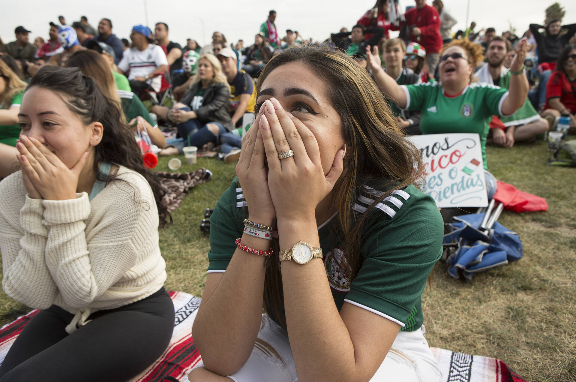 """Sunnyvale resident Nancy C. Silva expresses shock at the second goal by Brazil. """"I'm heartbroken,"""" she said. """"We're still proud of our team, we're always here to support."""" Anne Wernikoff/KQED"""